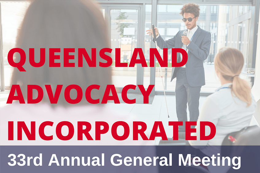 """Photo of a meeting with text that says """"Queensland Advocacy Incorporated 33rd Annual General Meeting"""""""