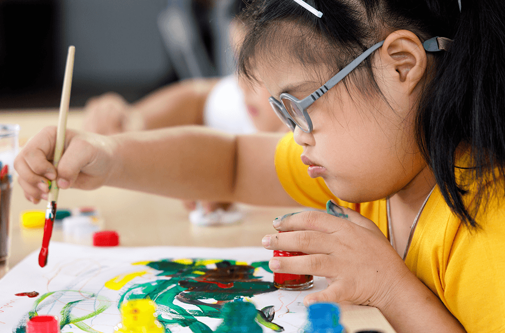 Photo of Asian girl with disability painting