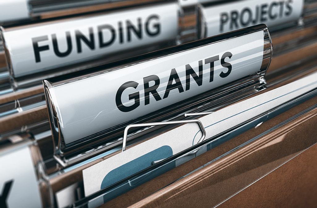 Close up photo of folders labelled Grants, Funding and Projects