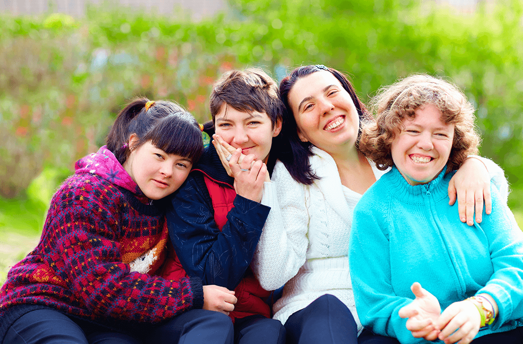 Photo of a group of happy women with disability in a park