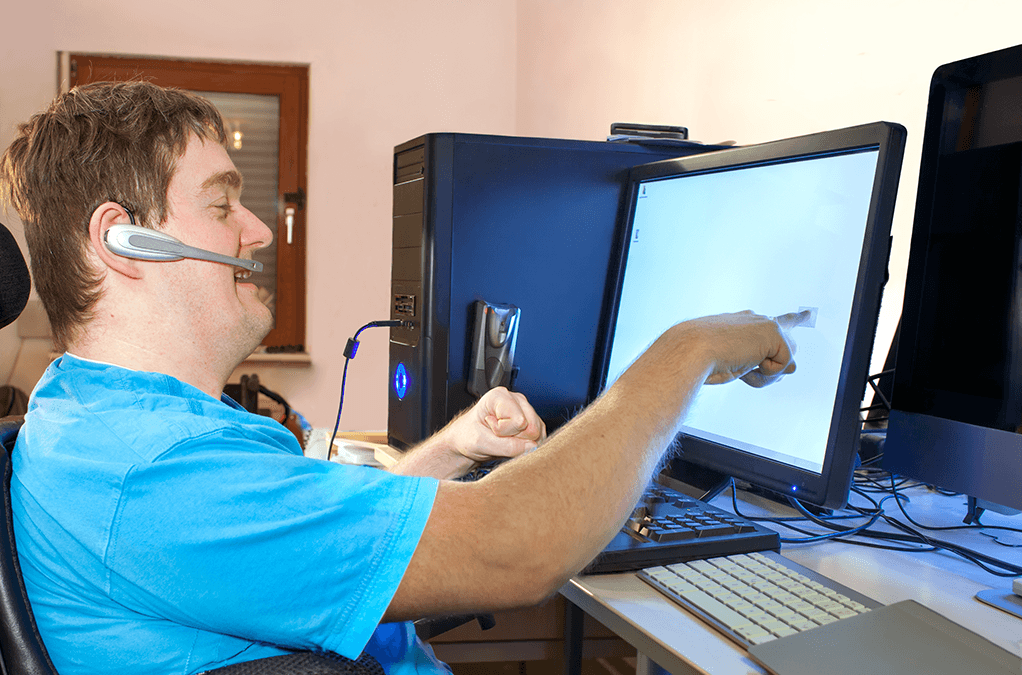 Photo of a man with disability working at computer