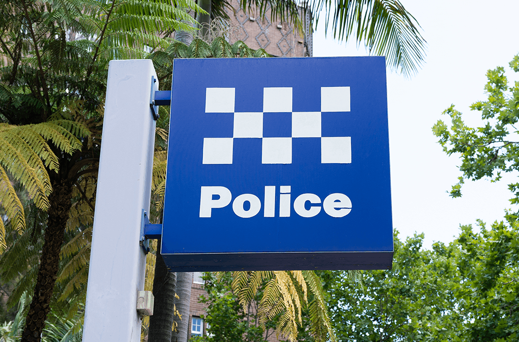 Photo of police station signpost