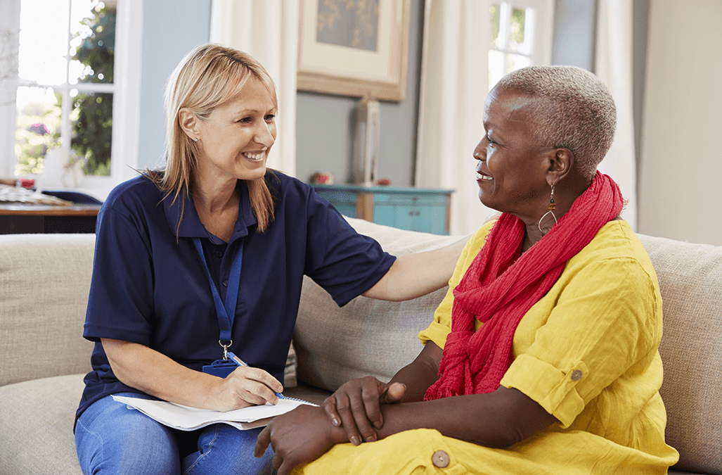 Photo of support worker with client